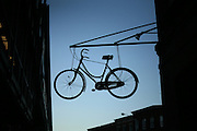 Bike hanging out of a restaurant in Brooklyn, New York. 2010