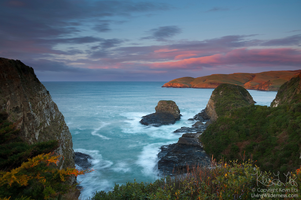 Pacific Ocean waves pound the rugged coast at the Catlins Heads near Owaka, New Zealand.