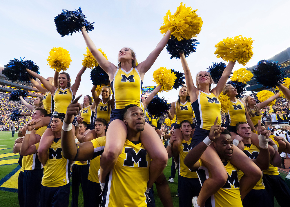 Oct 10, 2015; Ann Arbor, MI, USA; Michigan Wolverines cheerleader celebrate after the game against the Northwestern Wildcats at Michigan Stadium. Michigan won 38-0. Mandatory Credit: Rick Osentoski-USA TODAY Sports