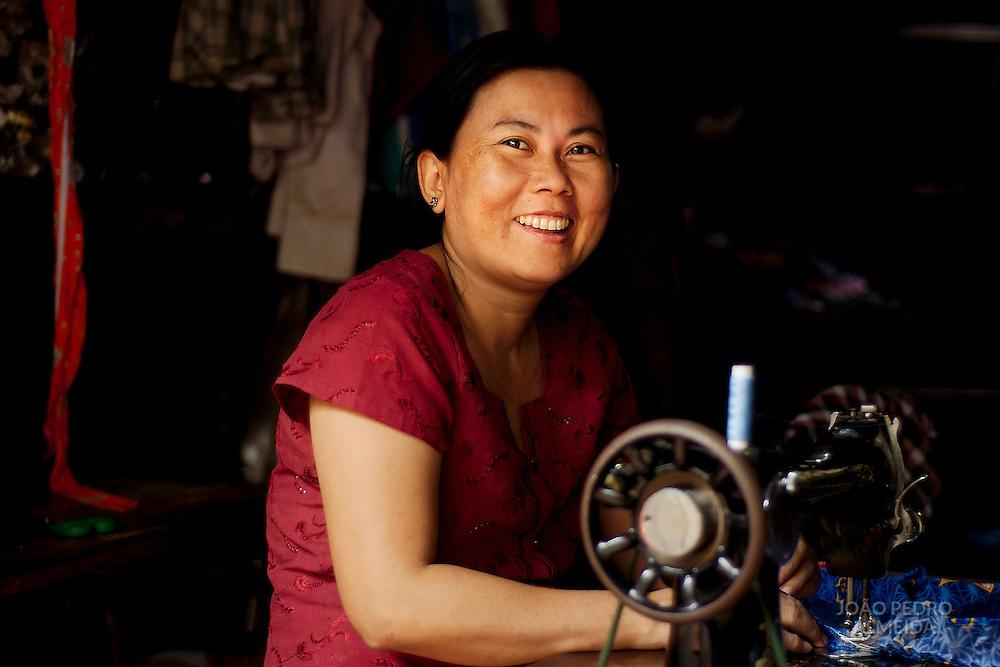Seamstress at small shop in Mandalay