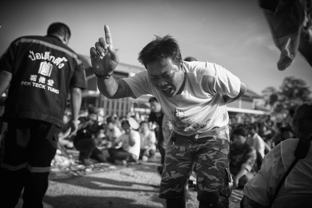 """A devotee works himself into a frenzy during the annual """"Wai Kru"""" tattoo festival at Wat Bang Pra in Nakhon Chasi, Thailand Saturday, March 23, 2013. Devotees attend the one day event to have their """"Sak Yant"""" religious tattoos energized by Buddhist monks and tattoo masters."""