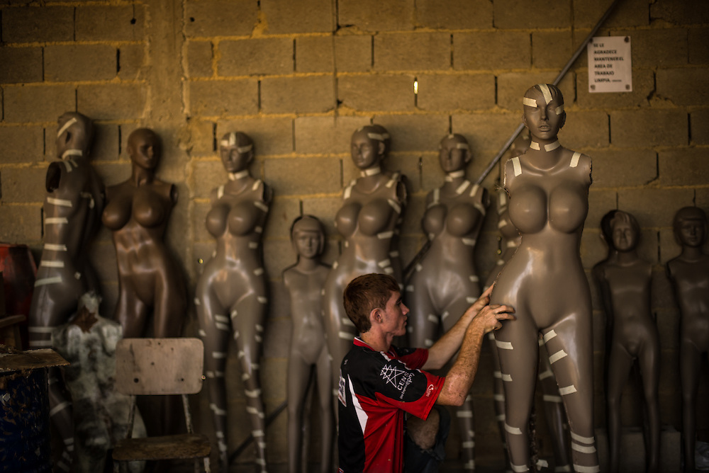 VALENCIA, VENEZUELA -OCTOBER 30, 2013: Workers construct mannequins at Eliezer Alvarez's workshop in Valencia. Alvarez  made a simple observation: Venezuelan women were increasingly using plastic surgery, yet the mannequins in clothing stores did not reflect these new, more ample proportions.<br /> So he crafted a new mold in his workshop and created his version of the perfect woman: bulging breasts and cantilevered buttocks, wasp waist and long legs, a fiberglass fantasy of beauty, Venezuelan style. CREDIT: Meridith Kohut for The New York Times