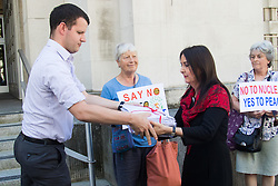 Ministry of Defence, Westminster, July 18th 2016. A petition with over 40,000 signatures is handed in to the Ministry of Defence, calling for the abandonment of the Trident Nuclear deterrent programme ahead of a debate on the issue in Parliament. PICTURED: SNP MP Margaret Ferrier hands over the petition to an MOD representative.