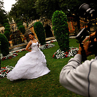 MIAMI, FL -- January 21, 2008 -- Melissa Capote of Miami gets her quinceañera photo taken by Photography by Padilla at Vizcaya Museum & Gardens in Miami, Fla., on Saturday, January 21, 2008.  Agricultural industrialist James Deering built Vizcaya Museum & Gardens in 1916 with ornate gardens and sculpture surrounding the massive main house. .