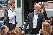 Alexander Pechtold (links) wacht op Diederik Samsom die na afloop van het debat nog even met studenten praat. In Utrecht vindt tijdens de introductiedagen het eerste lijsttrekkersdebat plaats voor de Tweede Kamerverkiezingen. Diederik Samsom (PvdA), Alexander Pechtold (D'66), Arie Slob (ChristenUnie), Jolande Sap (GroenLinks) en Sybrand Buma (CDA) discussieerden vooral over de zaken die studenten aangaan. Pechtold en Samsom wonnen samen het debat.<br /> <br /> Alexander Pechtold (left) is waiting for Diederik Samsom who talks with students after the debate. At the introduction days for the Utrecht University freshmen, political leaders are debating for the first time to start the campaign for the elections of the Dutch parliament. Diederik Samsom (PvdA), Alexander Pechtold (D'66), Arie Slob (ChristenUnie), Jolande Sap (GroenLinks) and Sybrand van Haersma Buma (CDA) are debating mainly on issues concerning education. Samsom and Pechtold won this debate equally.
