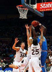 Nov 21, 2008; New York, NY, USA; UCLA Bruins center J'mison Morgan (22) scores a basket over Southern Illinois Salukis guard Ryan Hare (25) during second half action of the 2K Sports Classic consolation game at Madison Square Garden. UCLA defeated Southern Illinois 77-60.