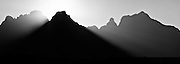 Outer Horn 3006m (9,860ft) silhouette and crepuscular rays, Bell 2930m and Cathedral Peak 3004m, Cathedral Peak Hotel.  Ukhahlamba-Drakensberg Park, KwaZulu-Natal, South Africa. Nikon F100, 70-300/4-5.6D. Kodak E100VS.