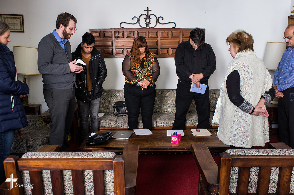The Rev. Andrew Schlund, LCMS missionary to Mexico, prays with his parishioners before a council meeting at Lutheran Church of The Good Shepherd on Saturday, Jan. 14, 2017, in Mexico City. Standing with Schlund are, left to right, Debora Potter, Jimmy Zeferimo, Nancy Rosete and Alejandro Arevalo, David Linares and Nory Bazzano Mastelli. LCMS Communications/Erik M. Lunsford
