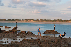 Locals relaxing at Cable Beach on the super low tide 22 March 2011