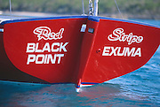 "356204-1131 ~ Copyright: George H. H. Huey ~ Transom of Class ""A"" Bahamian sloop. ""Red Stripe"", with hailing port of Black Point, Exuma. National Family Island Regatta, Bahamas."