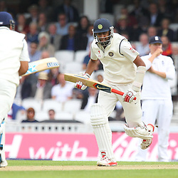 India's Ravichandran Ashwin scores runs  during the first day of the Investec 5th Test match between England and India at the Kia Oval, London, 15th August 2014 © Phil Duncan | SportPix.org.uk