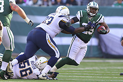 Dec 23, 2012; East Rutherford, NJ, USA; San Diego Chargers defensive tackle Cam Thomas (93) tackles New York Jets running back Bilal Powell (29) during the first half at MetLIfe Stadium.