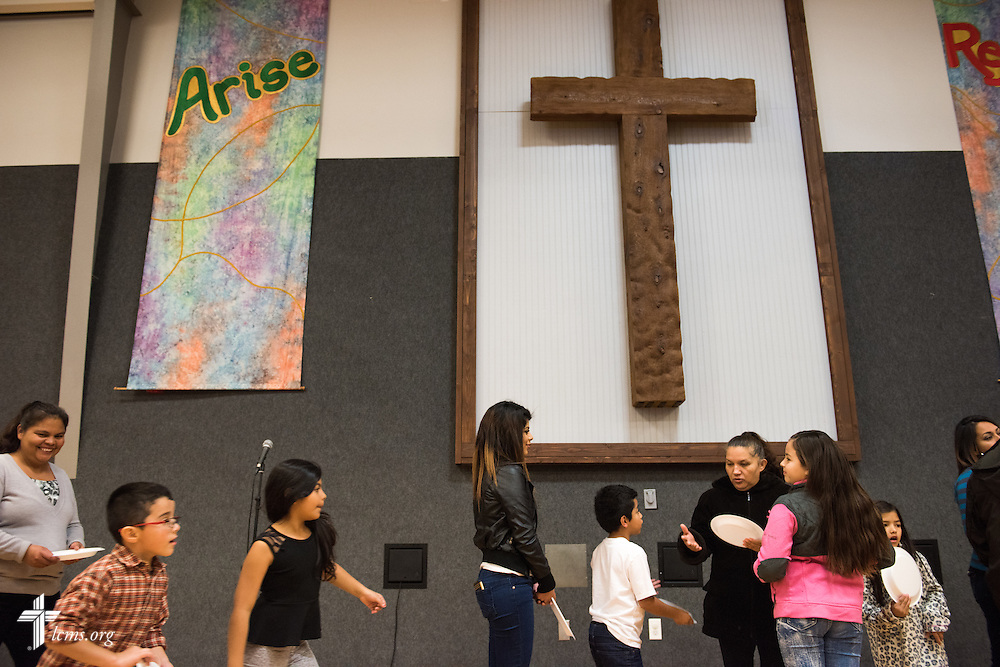Church members and guests line up for a fellowship meal following a monthly bilingual worship on Sunday, Nov. 22, 2015, at Salem Lutheran Church in Springdale, Ark. LCMS Communications/Erik M. Lunsford