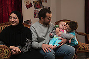 CAIRO, EGYPT - FEBRUARY 25: Al Jazeera English (AJE) producer Baher Mohamed (c) and his wife Jehan Rashed (l) play with their infant son Haroun February 25, 2015 and son Hazem (r) at their family apartment in the Sheikh Zayed district on the outskirts of Cairo, Egypt. Jehan was 7 months pregnant when Baher was arrested and then gave birth to Haroun while Baher was being detained in an Egyptian prison last year.  (Photo by Scott Nelson, for the Washington Post)