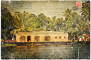 Traditional houseboats called kettuvallams are a big tourist attraction on the Kerala backwaters on the Malabar Coast of India.