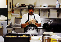 """Cynthia Comeaux prepares Country Cuisine's stuffed breads. """"I'm the lady behind the scenes,"""" said Comeaux about her job at the restaurant."""