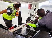 Linemen for Fontainebleau Aviation ready an aircraft for towing.
