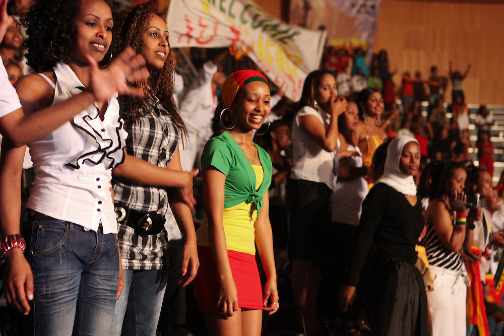 Ethiopian women, most of whom are employed as domestic workers in Lebanon, cheer Teddy Afro at his concert in Beirut.