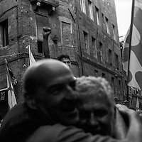 The Onda jockey is carried in the street of Siena after winning the race