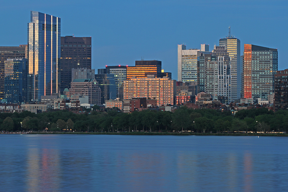 Boston skyline night photography featuring iconic skyscrapers and some of the tallest buildings in Boston such as the Boston State Street Corporation, The Federal Reserve Bank of Boston, the Millennium Tower and the One Financial Center at Dewey Square on a magnificent summer night. The Millennium Tower, with its nickname Millie, is located at Downtown Crossing and is one of the latest Boston urban architecture skyline addition. Boston skyline photos are available as museum quality photography prints, canvas prints, acrylic prints or metal prints. Fine art prints may be framed and matted to the individual liking and decorating needs:<br />  <br /> http://juergen-roth.pixels.com/featured/the-millennium-tower-juergen-roth.html<br /> <br /> All photographs are available for digital and print image licensing at www.RothGalleries.com. Please contact me direct with any questions or request.<br /> <br /> Good light and happy photo making!<br /> <br /> My best,<br /> <br /> Juergen<br /> Prints: http://www.rothgalleries.com<br /> Photo Blog: http://whereintheworldisjuergen.blogspot.com<br /> Instagram: https://www.instagram.com/rothgalleries<br /> Twitter: https://twitter.com/naturefineart<br /> Facebook: https://www.facebook.com/naturefineart