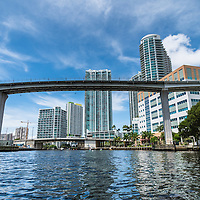 Kayakers pass under the Miami Metromover viaduct on the Miami River in downtown Miami, Florida.