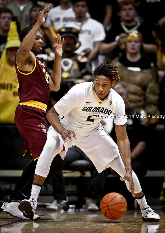 SHOT 2/19/14 10:17:31 PM - Colorado's Xavier Johnson #2 tries to muscle his way past Arizona State's Jermaine Marshall #34 during their regular season Pac-12 basketball game at the Coors Events Center in Boulder, Co. Colorado won the game 61-52.<br /> (Photo by Marc Piscotty / &copy; 2014)