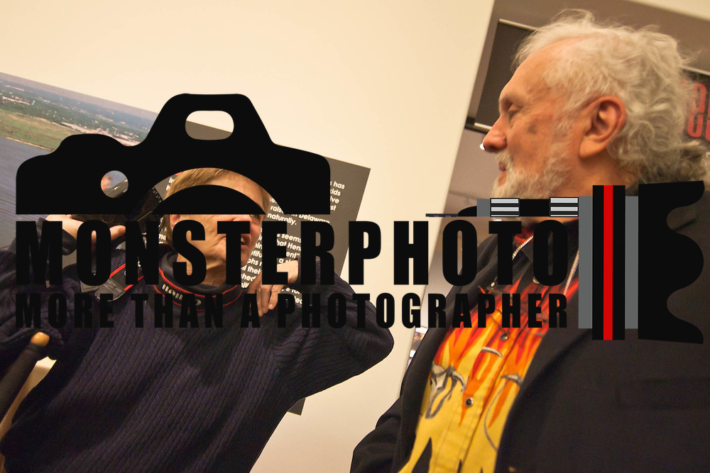 "021111 Wilmington DE: fellow photographers Ginger Wall ""Left""  and Peter Kaplan ""Right""  chat during The opening of the Fred Comegys Exhibitions at The Delaware Art Museum Friday in Wilmington Delaware...Special to The News Journal/SAQUAN STIMPSON...Special to The News Journal/SAQUAN STIMPSON"