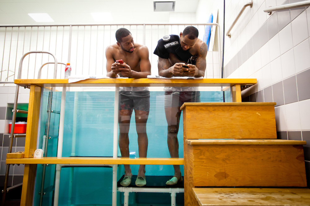 MIAMI, FL -- January 29, 2012 -- Miami guard Dwyane Wade, left, and forward LeBron James stand in a chiller tank of 43 degree water in the locker room after the Heat's 97-93 win over the Chicago Bulls at American Airlines Arena in Miami, Fla., on Sunday, January 29, 2012.  (Chip Litherland for ESPN the Magazine)