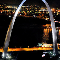 Gateway Arch from Aerial View at Night in St. Louis, Missouri<br /> The symbol of St. Louis, Missouri, is the Gateway Arch. The landmark is a 630 foot tall, shining ribbon of steel. The world&rsquo;s tallest arch has 1,076 steps. It is easier to take the tram to the top. Although Franklin D. Roosevelt approved partial funding in 1934, the keystone was not placed until 1965. When it was finished in 1968, Vice President Hubert Humphrey had the honors of dedicating it during an opening ceremony. The $13.5 million project gets its name from the Mississippi River&rsquo;s location as the gateway to the west.