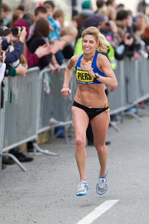 2013 Boston Marathon: masters woman Sheri Piers smiles with a mile to go