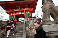 Hugh Montgomery, journalist for The Independent, tries Kyoto street food as he sits on steps near Kiyomizudera Temple, in Kyoto, Japan, on Friday 13th January 2012.