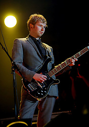 Robert Byron Hardy of Franz Ferdinand, on stage at Prince's Street Gardens, Edinburgh, Scotland, August 2005..©Pic : Michael Schofield...