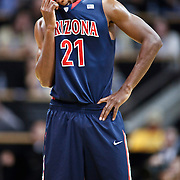SHOT 1/21/12 6:33:03 PM - Arizona's Kyle Fogg #21 reacts during a foul attempt during their PAC 12 regular season men's basketball game against Colorado at the Coors Events Center in Boulder, Co. Colorado won the game 64-63..(Photo by Marc Piscotty / © 2012)