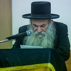 London, UK - 3 December 2014: the community Rabbi speaks as Mr Stephen Williams MP, Parliamentary Under Secretary of State for Communities and Local Government, visits Talmud-Torah Yetev-Lev orthodox Jewish school in Hackney, London