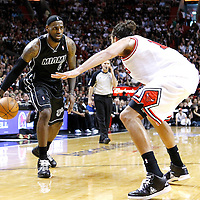 29 January 2012: Chicago Bulls center Joakim Noah (13) defends on Miami Heat small forward LeBron James (6) during the Miami Heat 97-93 victory over the Chicago Bulls at the AmericanAirlines Arena, Miami, Florida, USA.