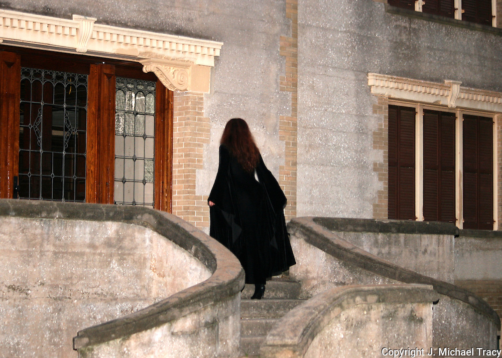 Witchy woman on stone staircase, at the most haunted house on Jekyll Island, Hollybourne Cottage.