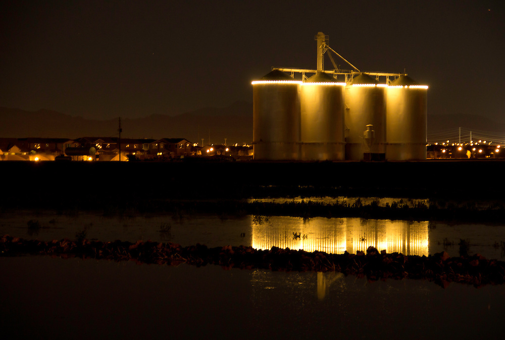 Gilbert Silos at night with Jupiter and the Superstition Mountains in the back ground