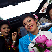 Beauty contestants wait to perform during festivities at Thailand's Phi Ta Khon Ghost festival Friday, June, 22nd, 2012, in Dan Sai, Thailand.  The Dan Sai Ghost Festival is unique to the Isan area of Thailand in the east and is part of local beliefs in spirits and ghost and is also a Buddhist merit making festival.  The ghost masks are made from bamboo sticky rice cookers and the costumes usually strips of cloth sewn together.  The origins of the Phi Ta Khon Festival are said to come from Buddha's last great incarnation before attaining Enlightenment.