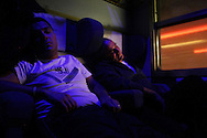 EXP 823 Freccia del sud. People sleep during the long journey (24 hours) from Agrigento (Sicily) to Milan (Lombardia) Because of the severe economic crisis that is crossing the Italy south, many workers, including many fathers, are forced to emigrate to the north Italy to look for jobs at the factory.<br />
