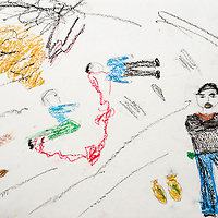 """""""This drawing shows that some people are fighting in the war just for money."""" Drawing by Syrian girl, age 13. (Topic for this session: dealing with loss.)"""