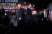 Secret Service agents stand guard at  a campaign rally for Republican vice presidential candidate Rep. Paul Ryan in Fort Myers, Florida, October 18, 2012.