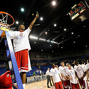 Western Kentucky Hilltoppers guard Jamal Crook (14) shows off a piece of the net Tuesday, March 6, 2012, during the Sun Belt Conference Basketball Tournament finals at the Summit Arena in Hot Springs, Ark. (Photo by Joe Imel/Daily News)