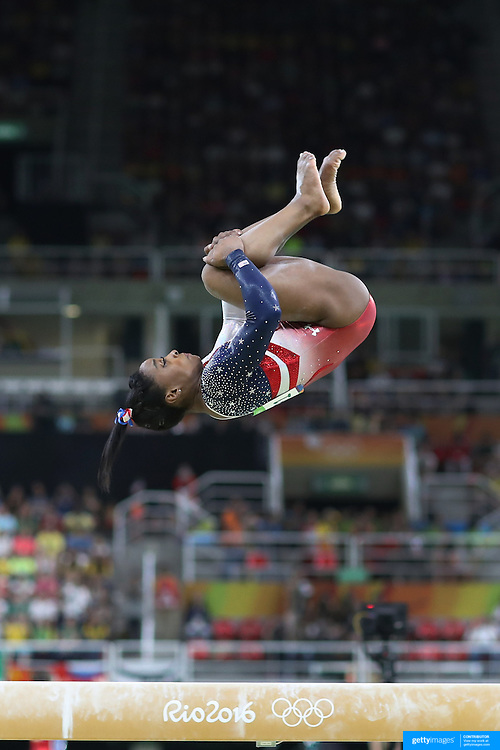 Gymnastics - Olympics: Day 4   Simone Biles of the United States performing her routine on the Balance Beam during the Artistic Gymnastics Women's Team Final at the Rio Olympic Arena on August 9, 2016 in Rio de Janeiro, Brazil. (Photo by Tim Clayton/Corbis via Getty Images)