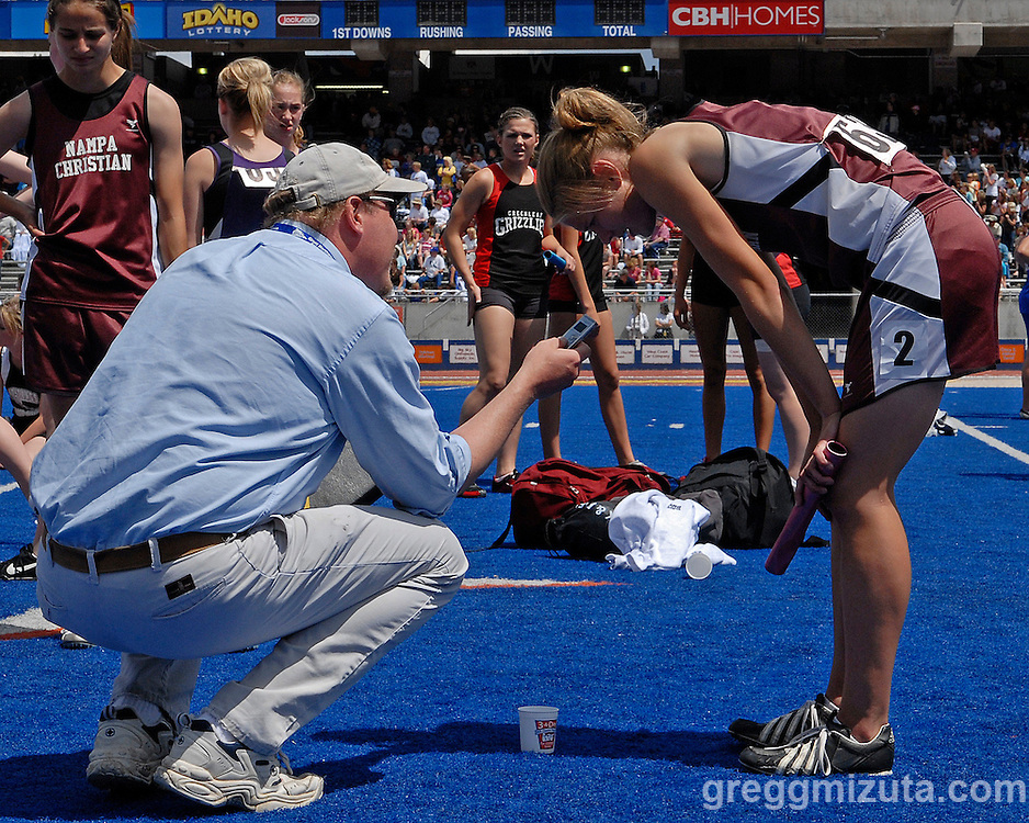 Idaho Press-Tribune reporter Mike Stetson gets down to interview Nampa Christian junior Kaycee Brunel who is still catching her breath from anchoring their winning relay team during the 2008 Idaho State Track and Field Championships at Boise State University's Bronco Stadium on May 24, 2008.