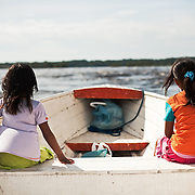 Girls in the boat at Rio Negro (Black River), around Sao Gabriel da Cachoeira town. Amazonas State, Brazil.