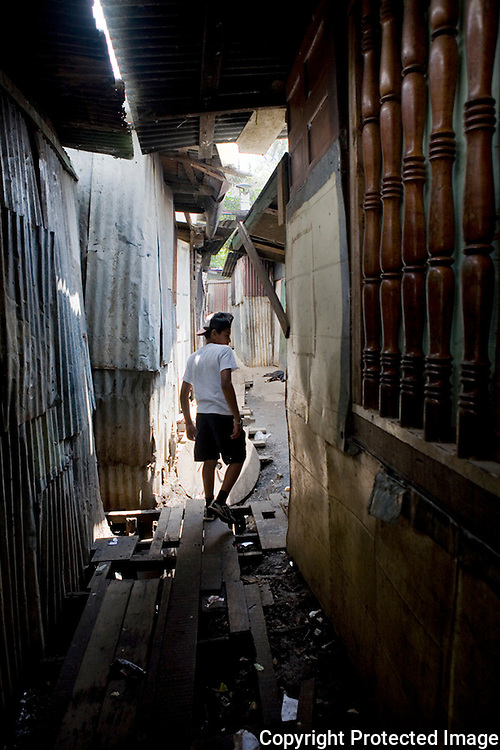 Isreal searching for his friends in the alleys of San Felipe. Most of the sidwalks here are made from rotting pieces of wood. At least feet stay dry and clean from the mud.