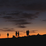 In the fall and winter, Cadillac Mountain in Acadia Ntaional Park, Maine is the first to recieve the rays of the morning sun. No visit to the park, when the road is passable, is complete without watching the sunrise  the summit. Here, visitors gather to enjoy nature's light show.