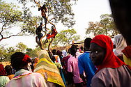 Unaccompanied minors at the Yida refugee camp sing and dance. . The Lost boys of Sudan may be the best known example of the horror of Sudan's civil war, a conflict that was supposed to end with the independence of the South last July.  Countless South Sudanese boys were forced to flee, separated from their families, walking for days and weeks across hostile lands to the relative safety of a refugee camp. Many died on the way. .Now, this story is repeating itself as thousands of children, separated from their families by constant bombardment, starvation and battles are fleeing the same unresolved conflict, this time in the Nuba mountains of Sudan, where the Khartoum government has been at war with it's own people for over a year. The Sudan government's endless bombing campaigns of civilian targets like schools, churches, markets and boreholes has divided up families and separated children from their parents, and orphaned others..Over 3000 of these children have ended up at the Yida refugee camp, a controversial refuges for the Nuban people close to the North South border that the UN refuses to recognize as a camp for fear of being seen as supporting the rebels. The children have horrific stories. 20 year old John first lost his family in a bombing, he then lost his two younger brothers to starvation, without even the energy to bury them, he walked south for days until he arrived in Yida. 12 year old Rose fled with her entire boarding school after it was bombed and many of here fellow students and teachers killed. Robert watched his family stoned to death after a desperate group of refugees was ambushed by a Northern militia on the border..A few volunteer caretakers and teachers tend to the children. 22 year old Jamina who was separated from her own mother for 11 years during the last war. Today she watches over 500 girls in the same position. Packed into grass huts they built themselves the children try to study, and play and forget the past. ?The only way to stop th