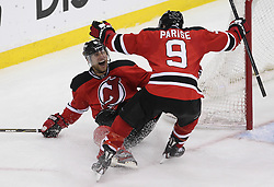 May 6, 2012; Newark, NJ, USA; New Jersey Devils left wing Zach Parise (9) and New Jersey Devils right wing Dainius Zubrus (8) celebrate Zubrus' empty net goal during the third period in game four of the 2012 Eastern Conference semifinals at the Prudential Center.  The Devils defeated the Flyers 4-2.