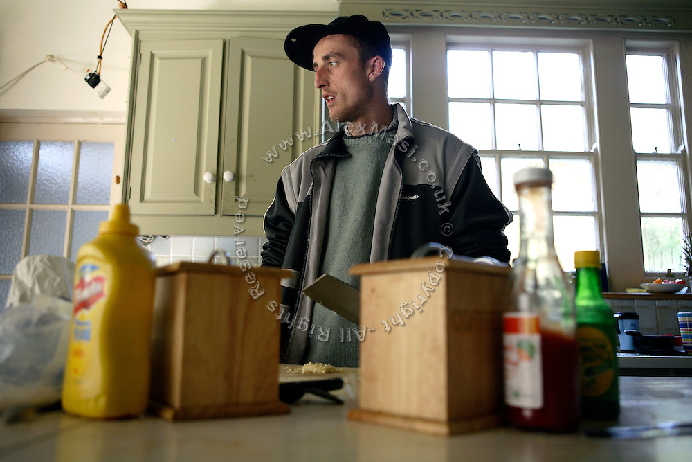 Lee, 26, from West London is chopping garlic in the kitchen of the Ingram Avenue mansion on Thursday, Oct. 11, 2007, in Hampstead, London, England. The 22-room mansion was last sold for UK£ 3.9M in 2002 and is now awaiting planning permissions to be demolished. Two new houses will soon be taking its place. Million Dollar Squatters is a documentary project in the lives of a peculiar group of squatters residing in three multi-million mansions in one of the classiest residential neighbourhoods of London, Hampstead Garden. The squatters' enthusiasm, their constant efforts to look after what has become their home, their ingenuity and adventurous spirit have all inspired me throughout the days and nights spent at their side. Between the fantasy world of exclusive Britain and the reality of squatting in London, I have been a witness to their unique story. While more than 100.000 properties in London still lay empty to this day, squatting provides a valid, and lawful alternative to paying Europe's most expensive rent prices, as well as offering the challenge of an adventurous lifestyle in the capital.